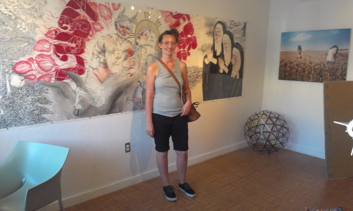 Helen Bayly in front of her large-scale work on paper at Aqua Art Miami, 2012