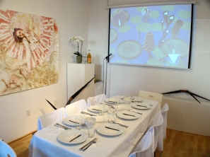 Before the party, a clean table and lots of art. (photo by Tim Roseborough)
